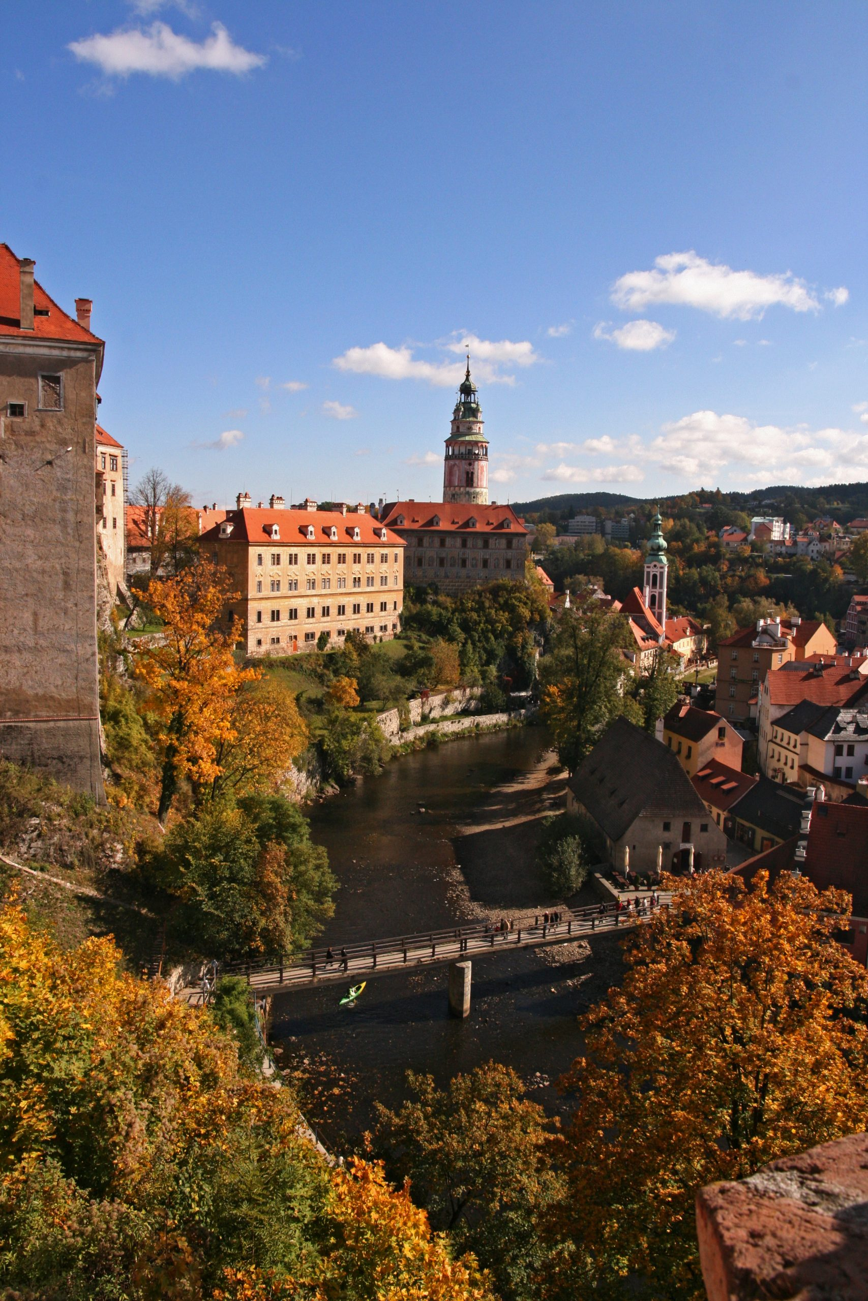 Cesky Krumlov Castle in the fall surrounded by trees
