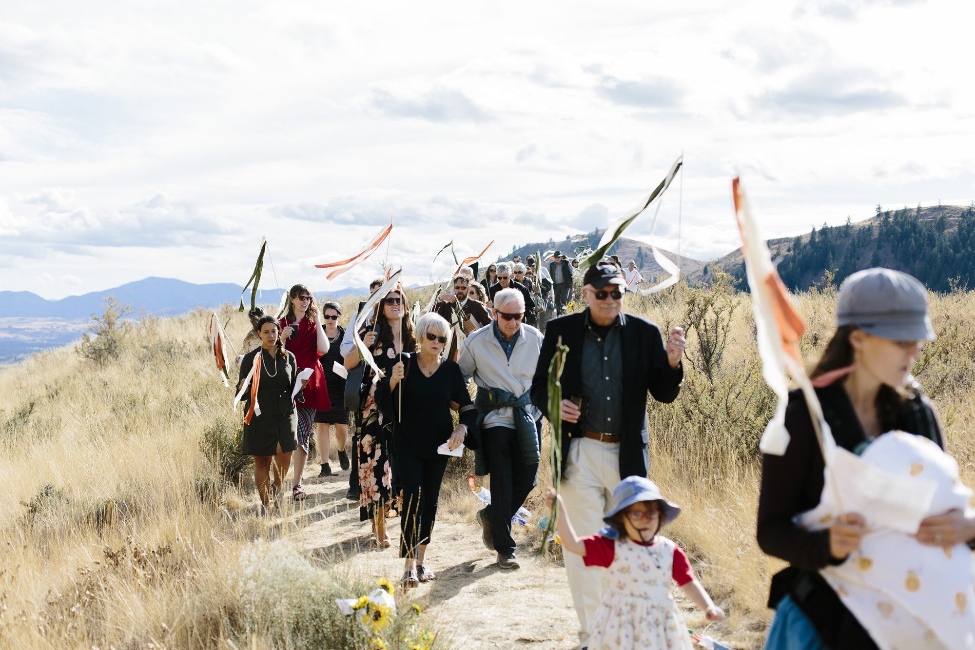 Processional down the mountain on foot with music after the ceremony
